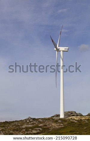 white wind turbine in the top of the mountain - stock photo