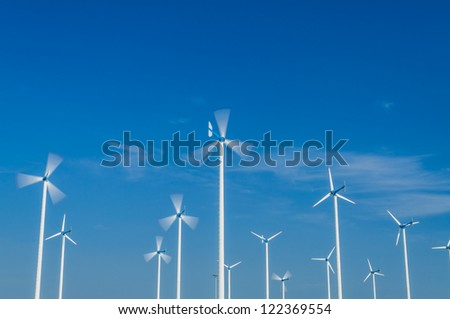White wind turbine. Subaltern's mountains and sky in the background.