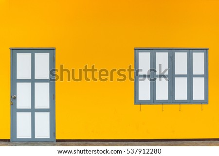 White window and door on yellow wall background.