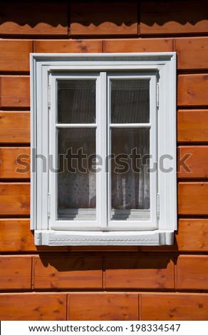 White window in the cabin - architecture detail
