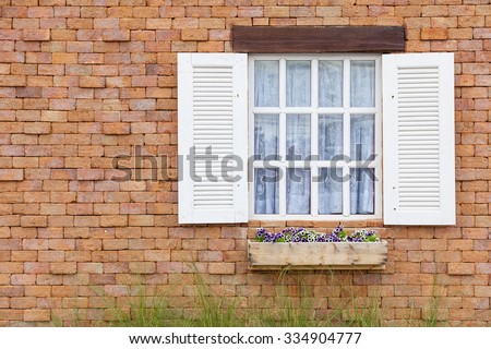 white window on brick wall