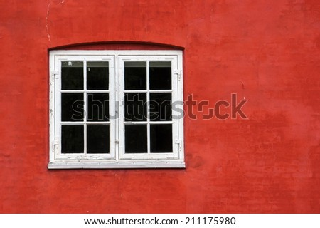 White window on the red wall - stock photo