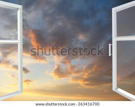 white window opened to the beautiful sunset - stock photo