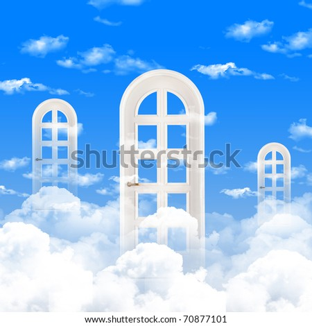 White windows and doors against the blue sky - stock photo