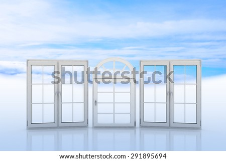 White windows with blue sky and clouds on the background - stock photo