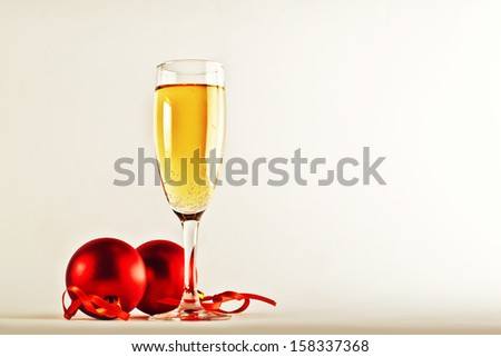 White wine and christmas balls. New Year's Eve decoration. - stock photo