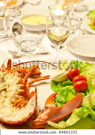 White wine and lobster as a luxury dinner plate - stock photo