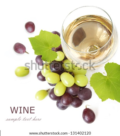 White wine and red and green grapes with leaves. Isolated on white - stock photo