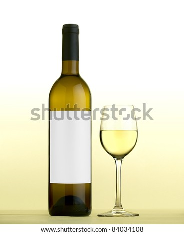 white wine and Wine glass, with white wine, with blank labels. - stock photo