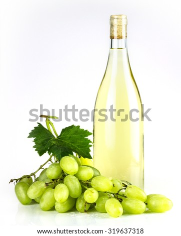 White wine bottle and grapes.