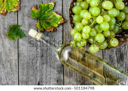 White wine bottle, flat lay, top view on rustic wooden background
