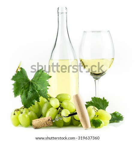 White wine bottle, wineglass, grapes, and corkscrew. - stock photo
