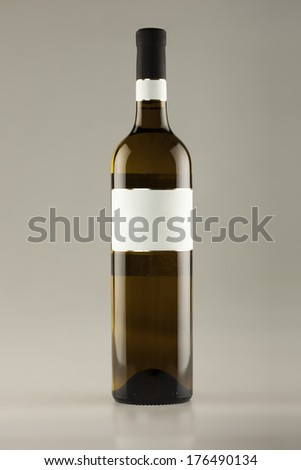 White wine bottle with empty label - stock photo