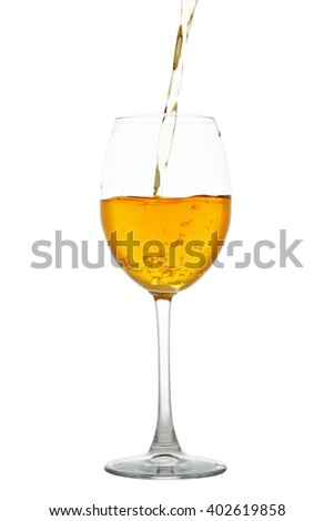 White wine flowing into a glass isolated on white background