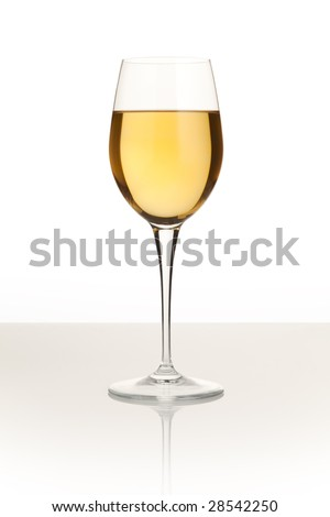 White wine glass on the white reflective table