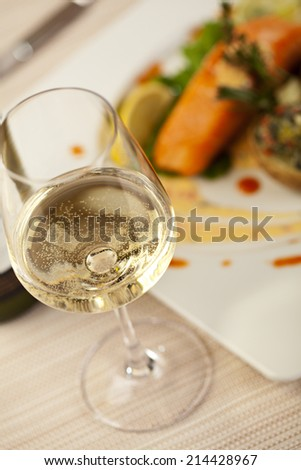 White Wine Glass. Salmon Steak on a Background