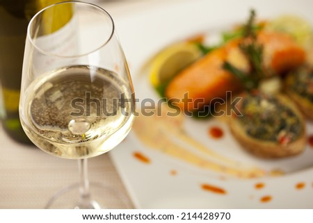 White Wine Glass. Salmon Steak on a Background - stock photo