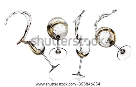 White wine glasses jump and splash 2016 signs - stock photo