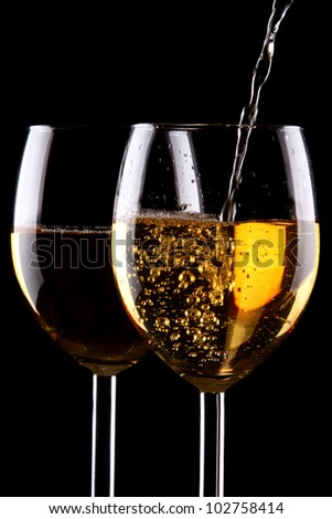 White wine glasses on black - stock photo