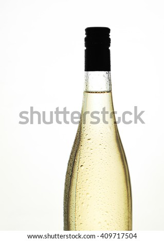 white wine in a bottle with no label, against a white background - stock photo