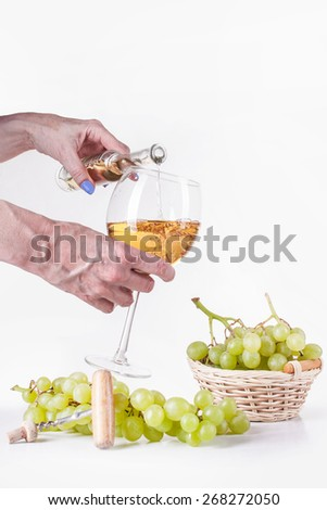 White wine in bottle and glass and a bunch of white grapes isolated on white
