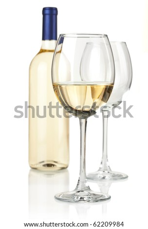 White wine in bottle and glasses. Over white
