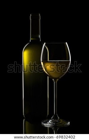 White wine in glass on black background close up - stock photo