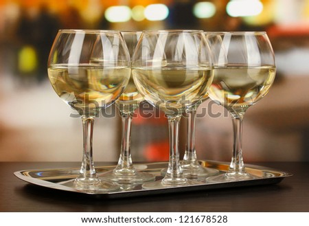White wine in glass on room background - stock photo