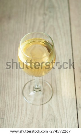 white wine in glass on vintage background