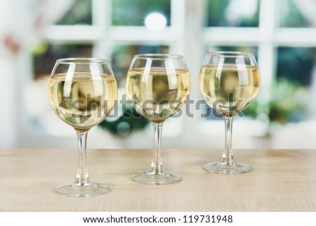 White wine in glass on window background - stock photo