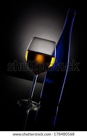 White wine on black background - stock photo