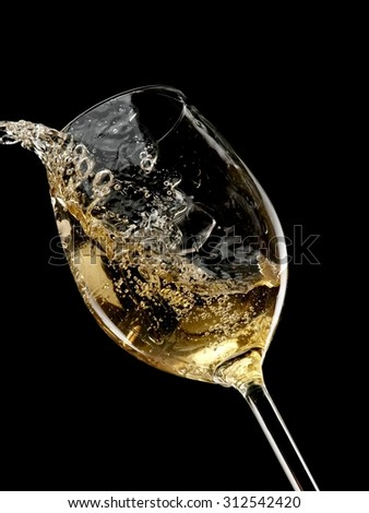 White wine plash on black background - stock photo