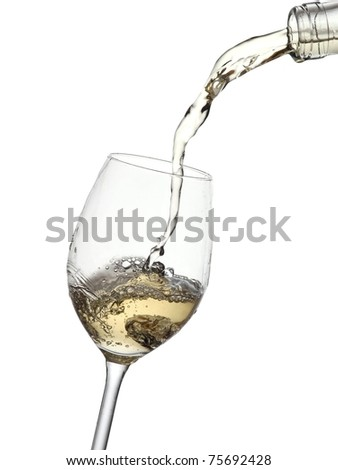 White wine pouring into a glass from a bottle - stock photo