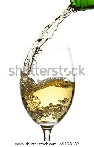 White wine pouring into glass