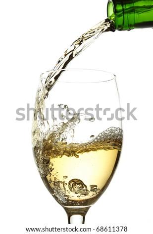 White wine pouring into glass - stock photo