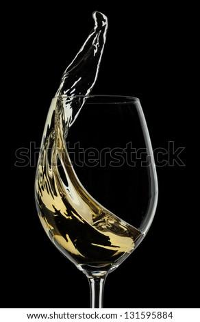 White wine splash on black background - stock photo