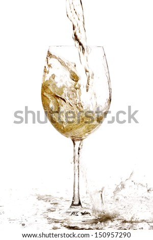 White wine splashing into and besides a glass