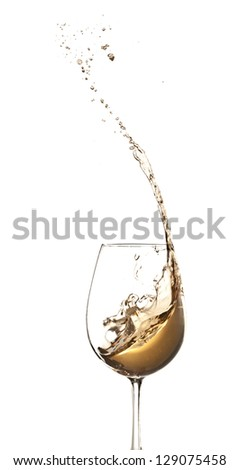 White wine splashing out of glass, isolated on white background