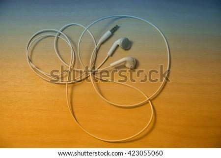 White wired earphones - stock photo