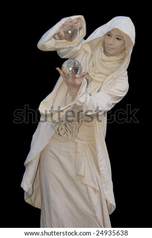White Wizard manipulating christal balls  isolated on black background. - stock photo