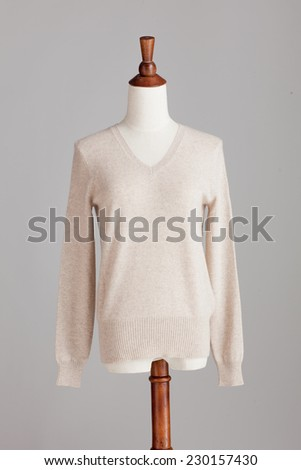 white woman cashmere sweater with wood model on grey isolated