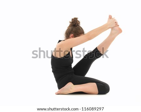 white woman dressed in black, performing difficult yoga pose, body view, on white background