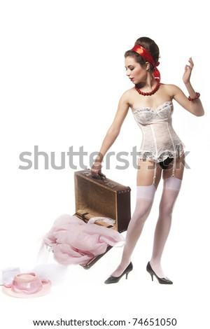 White woman in underwear with suitcase