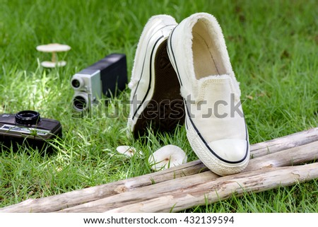 white women sneakers without laces in the garden