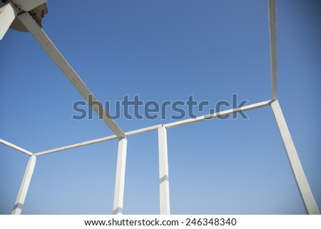 White wood construction home framing against blue sky, closeup of ceiling frame.  - stock photo