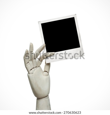 White wood hand with photo frame