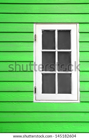 white wood window and green plank wall - stock photo