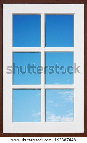 white wood window reflecting blue sky and cloud - stock photo