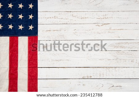 white wooden background with an American flag - stock photo