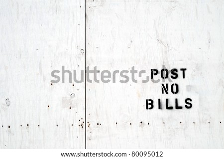 "White wooden board stamped ""Post no bills"" - stock photo"